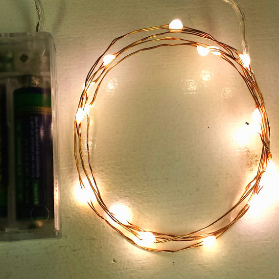 18 Fairy Lights on 3-ft string lights of copper, silver, or gold wire. Battery-operated with ...