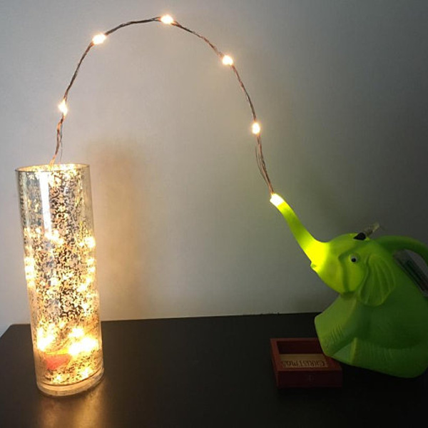 Small elephant watering can makes great night light.